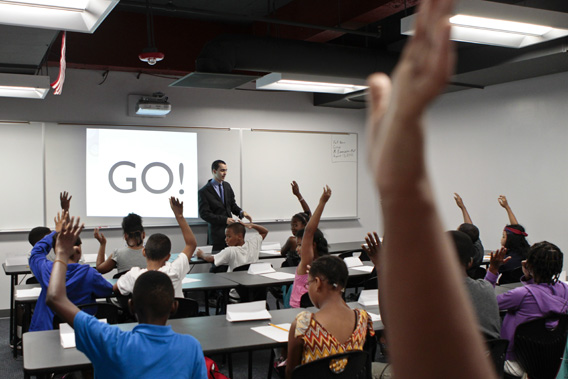 Math teacher Robert Biemesderfer asks students questions during the opening of a BASIS charter school, a brand that has been called one of the most challenging high schools in the country at a boot camp type program where students will begin to learn all of the behaviors that are expected of them at the school, as well as continue to catch up academically so that they can start the ultra-rigorous regular curriculum the following week in Washington, DC on Monday August 13, 2012.