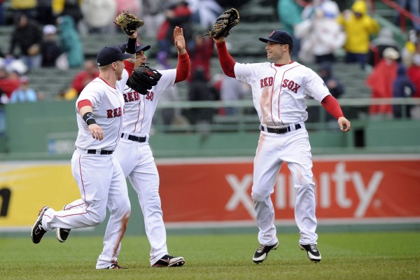Boston Red Sox outfielders Mike Carp (37), Jacoby Ellsbury (2) and Daniel Nava (29) celebrate their victory over the Cleveland Indians at Fenway Park in Boston Saturday.