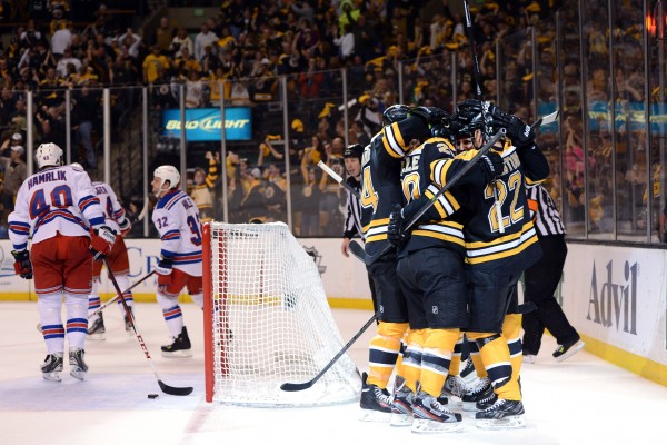 The Boston Bruins celebrate a goal by  forward Gregory Campbell (11) against the New York Rangers in game five of the second round of the Stanley Cup Playoffs at TD Garden in Boston Saturday night.