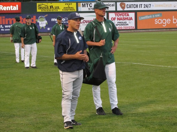 University of Maine baseball coach Steve Trimper (left) and Binghamton University coach Tim Sinicki chat while waiting to take their respective dugouts prior to Thursday's America East baseball tournament game in Lowell, Mass.