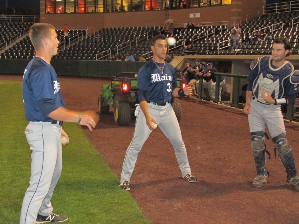 UMaine baseball players (from left) Shane Bussey, Kyle Silva and Mike Connolly enjoy a pregame contest of three-ball before Thursday night's America East playoff game in Lowell, Mass.