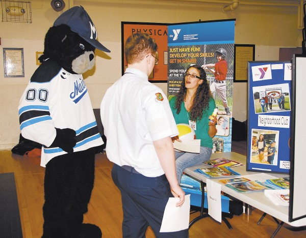 Bananas the Bear and a BHS ROTC student listen and learn at the Bangor Y booth.
