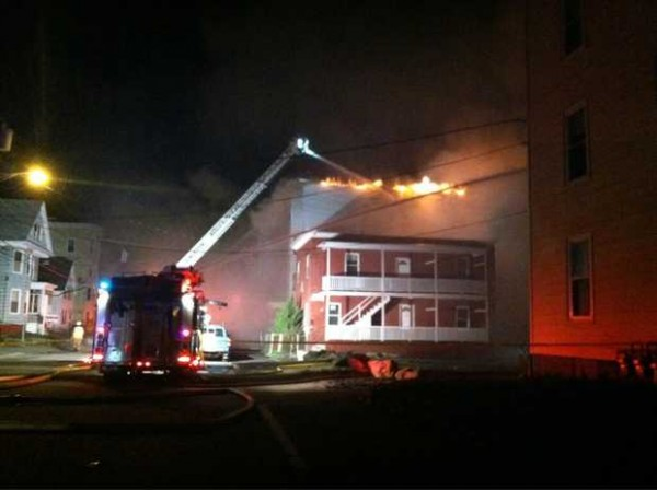 Firefighters battle a blaze on Pierce Street in Lewiston on Friday night.