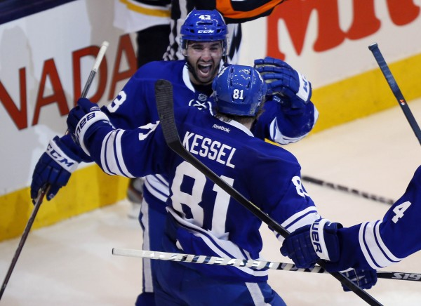 Toronto Maple Leafs forward Nazem Kadri (43) congratulates right wing Phil Kessel after his goal in the third period against the Boston Bruins in Game 6 of the first round of the Stanley Cup playoffs Sunday night at the Air Canada Centre in Toronto. Toronto defeated Boston 2-1.