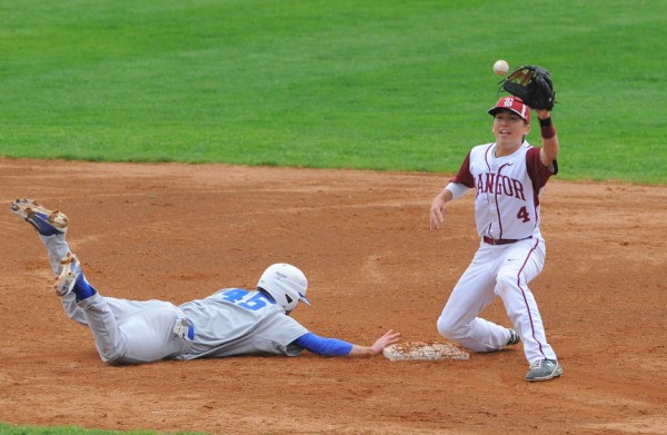 Lewiston's Colt Bernier (left) dives to second base beating the pick-off throw to Bangor's Kyle Stevenson during the game in Bangor on Friday.
