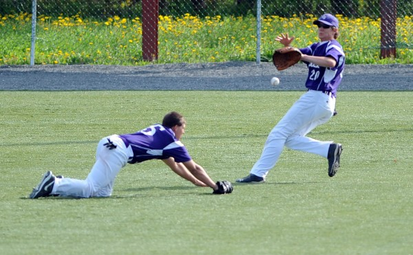 John Bapst's Shawn Curran, left, and Josh Baker scramble for a outfield fly ball against MDI on Friday at Husson University.