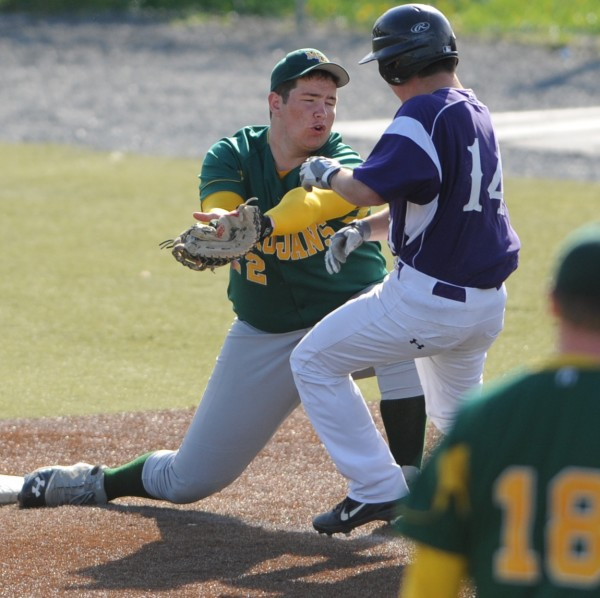 MDI first baseman Adam Gray gets the out on John Bapst's Joe Archambault on Friday at Husson University.
