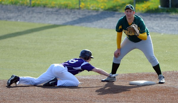 John Bapst's Andy Catlin makes it back to first safe as MDI's Adam Gray gets the throw from MDI pitcher Ben Walls on Friday at Husson University.