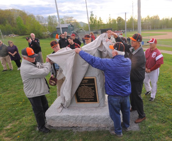A plaque is unveiled rededicating the Brewer High School baseball field to former Brewer teacher and baseball coach Charles Heddericg Monday night.