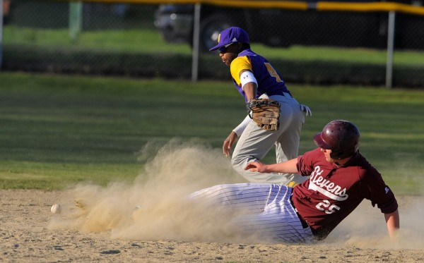 GSA's Cooper Smallidge (right) slides to second base as Bucksport's Josh Gray can't make the catch during the game in Bucksport on Wednesday.