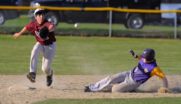 Bucksport's Bailey Graychase (right) slides to second base as GSA's Anthony Bianco catces the wide throw during the game in Bucksport on Wednesday