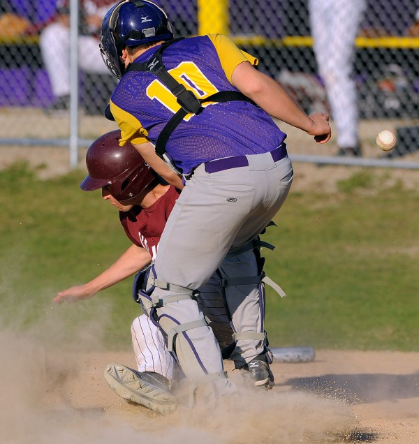 Bucksport's catcher Carter Dergedin (right) drops the ball as he collides with GSA's Ben Ely at the home plate during the game in Bucksport on Wednesday.
