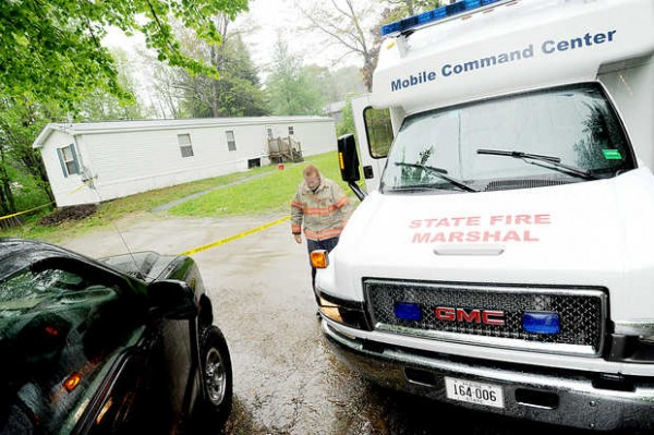 The Office of the Maine State Fire Marshal investigates a fire at 33 Highland Ave. in Mechanic Falls on Friday. The mobile home belongs to Michael Callahan's estranged wife, Laurie Callahan.