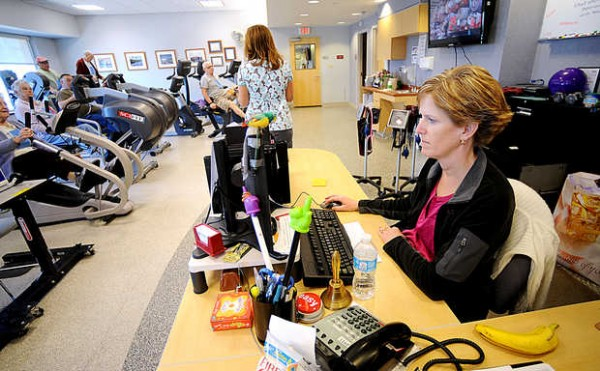 Registered nurse Brenda Robitaille monitors the blood pressures and heart rates of cardiac rehab patients during one of their thrice-weekly exercise session at the Central Maine Heart and Vascular Institute.
