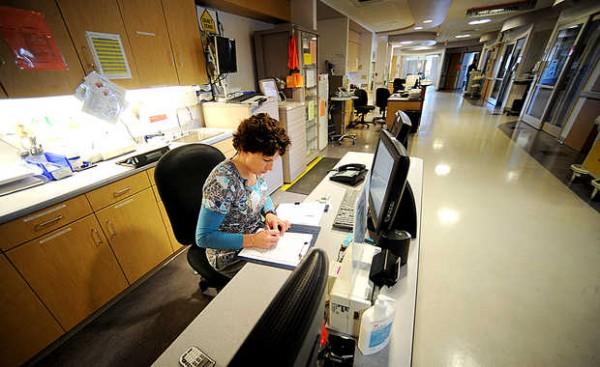 Lori Marquis-Boutin does paperwork on the same floor as the cardiovascular single-stay unit at the Central Maine Heart and Vascular Institute in Lewiston.