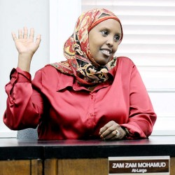 Zam Zam Mohamud votes for her first time Tuesday as a member of the Lewiston School Committee.