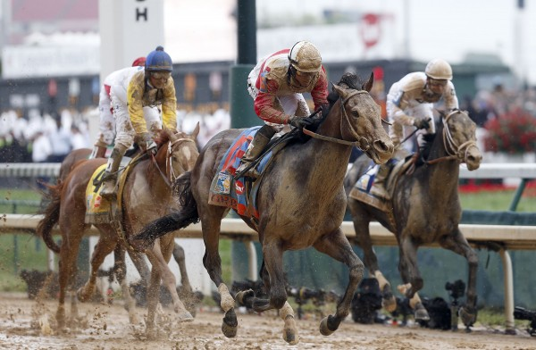Orb (front), with Joel Rosario, captures the 139th running of the Kentucky Derby at Churchill Downs in Louisville, Ky., on Saturday, May 4, 2013.