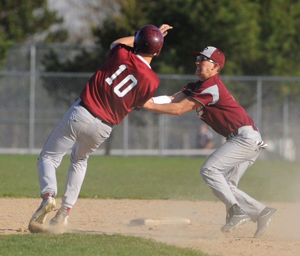 Washington Academy's Tyler Varney (right) tags Ellsworth's Tyler Getchell at second base during the game in Ellsworth on Tuesday.