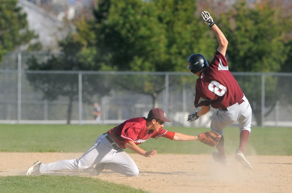 Ellsworth's Jacob Maguire (left) tags Washington Academy's Jordan Drouin at second base during the game in Ellsworth on Tuesday.
