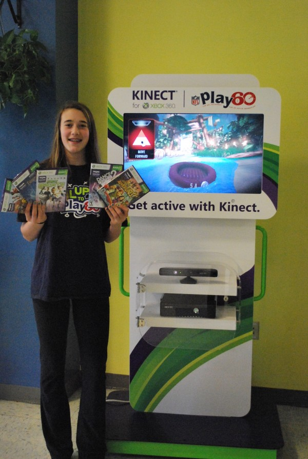 "Bath Middle School student Noa Sreden is pictured here with the portable XBox 360 Kinect Kiosk she and fellow classmate Ann Tolan won for their school during a nation-wide Fuel Up to Play 60 ""Casting Call"" Challenge in which the girls each submitted entries describing how the program has inspired fitness and better nutrition in their school. Sreden was recently recognized for her ongoing commitment to making healthy changes in schools and was chosen as the 2013-2014 Fuel Up to Play 60 State Ambassador. This summer she will travel to the Carolina Panthers NFL stadium in Charlotte, NC to attend the Fuel Up to Play 60 Student Ambassadors Summit."