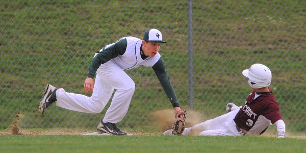 Old Town's Garvey Melmed (left) tags Foxcroft Academy's Caleb Richard as he slides to third base during the game in Dover-Foxcroft Tuesday afternoon.