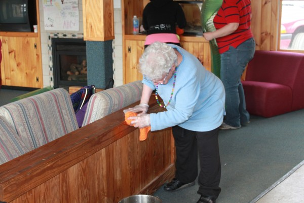 Program participant Carolyn Schuler helps with the