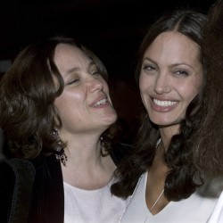 "Actress Angelina Jolie (R) and her mother Marcheline Bertrand pose together at the premiere of Jolie's film ""Original Sin"" in Hollywood in this July 31, 2001 file photo. Oscar-winning actress Jolie said on May 14, 2013 that she had undergone a preventive double mastectomy after finding out she had a gene mutation that leads to a sharply higher risk of both breast and ovarian cancer. Jolie, writing in the New York Times, said her mother's death from cancer at 56 and the discovery that she carried the BRCA1 gene mutation led to her decision out of fears she might not be around for her six children."