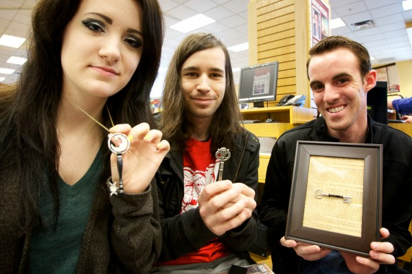 Ashley Brooks (from left) Shawn Ruarke and Ty Gowen show off keys inspired by Joe Hill's &quotLocke and Key&quotcomic book series. The trio were on hand Saturday at Books a Million in South Portland for a book signing by Hill.