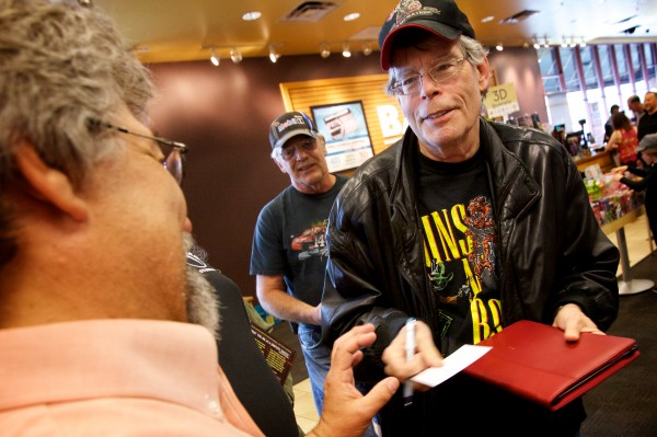 Stephen King signs autographs Saturday at Books a Million in South Portland. King was on hand for a book signing and reading by his son, Joe Hill.