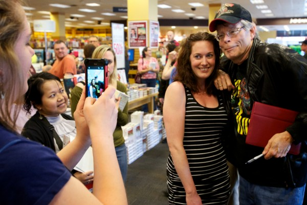 Stephen King poses for a photo with Tara McConnell of Westbrook Saturday at Books a Million in South Portland. King was on hand for a book signing and reading by his son, Joe Hill.