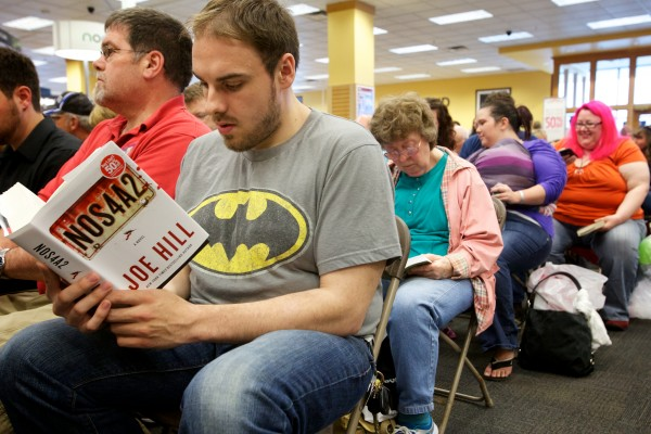 Tyler Brown of Waterville makes it to page 23 while waiting for a book signing and reading by Joe Hill to start Saturday at Books a Million in South Portland.