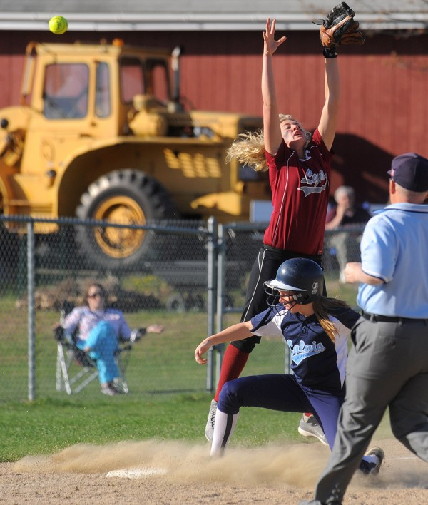 Mattanawcook Academy's Carly McDonald (top) can't make the catch as Calais's Maddy McVicar slides to third base during the game in Lincoln Monday.