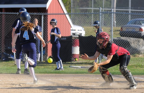 Mattanawcook Academy's Ashley Libby (right) catches the late throw as Calais's Maddy McVicar stepps on home plate during the game in Lincoln Monday.