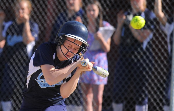 Calais's Meaghan Cavanaugh ducks under a high pitch during the game against Mattanawcook Academy in Lincoln Monday.