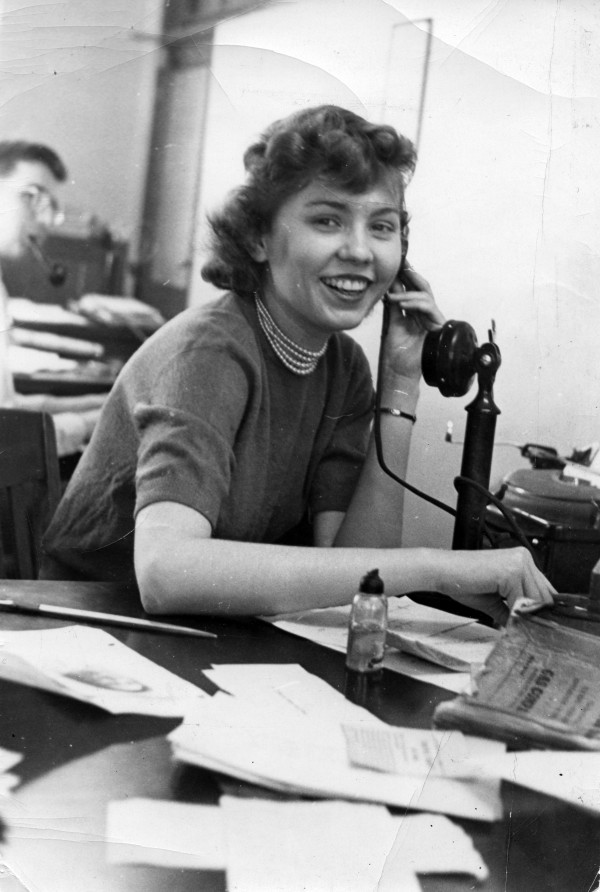 Judy McCartney working as a reporter in the newsroom of the Lansing State Journal in 1951.