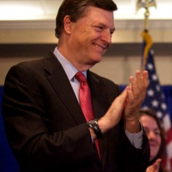 Former Maine Gov. John McKernan applauds his wife, Olympia Snowe, at a press conference in Portland last year.