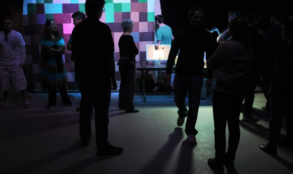 People walk around during the eighth annual New Media Night at the University of Maine in Orono Thursday. The even was held in the new Innovative Media Research and Commerce Center that is expected to be completed and open in September.