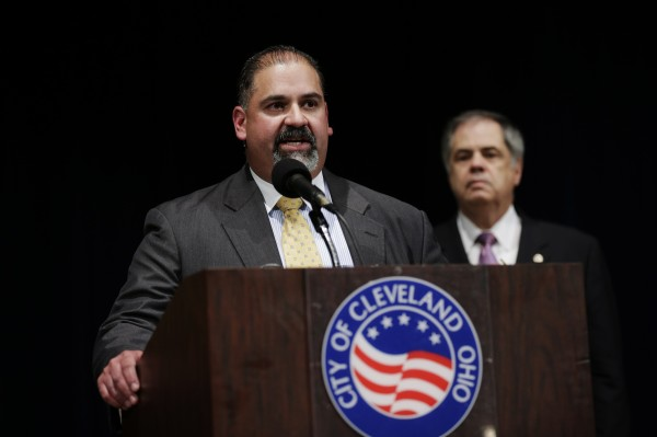 Cleveland City Prosecutor Victor Perez (L) answers a question as Public Safety Director Martin Flask looks on during a news conference in Cleveland, Ohio, May 8, 2013. Cleveland resident Ariel Castro was charged on Wednesday with kidnapping and raping three women who were rescued from his house on Monday after nearly a decade in captivity. Castro's two brothers Pedro and Onil, originally arrested in the case, were not charged, said Perez at a news conference.
