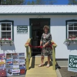 "Fabric Garden owner Michaela Murphy cutting the red ribbon of The Fabric Garden's new ""Corner Cottage""."