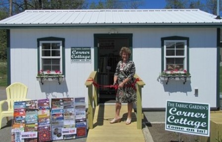 Fabric Garden owner Michaela Murphy cutting the red ribbon of The Fabric Garden's new &quotCorner Cottage&quot.