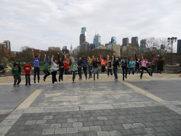 "The 9th grade Trekkers and mentors do a celebratory jump after climbing the ""Rocky Steps"" at the Philadelphia Museum of Art during the ""Ride Through History"" trek to Boston, Philadelphia and Washington, D.C."