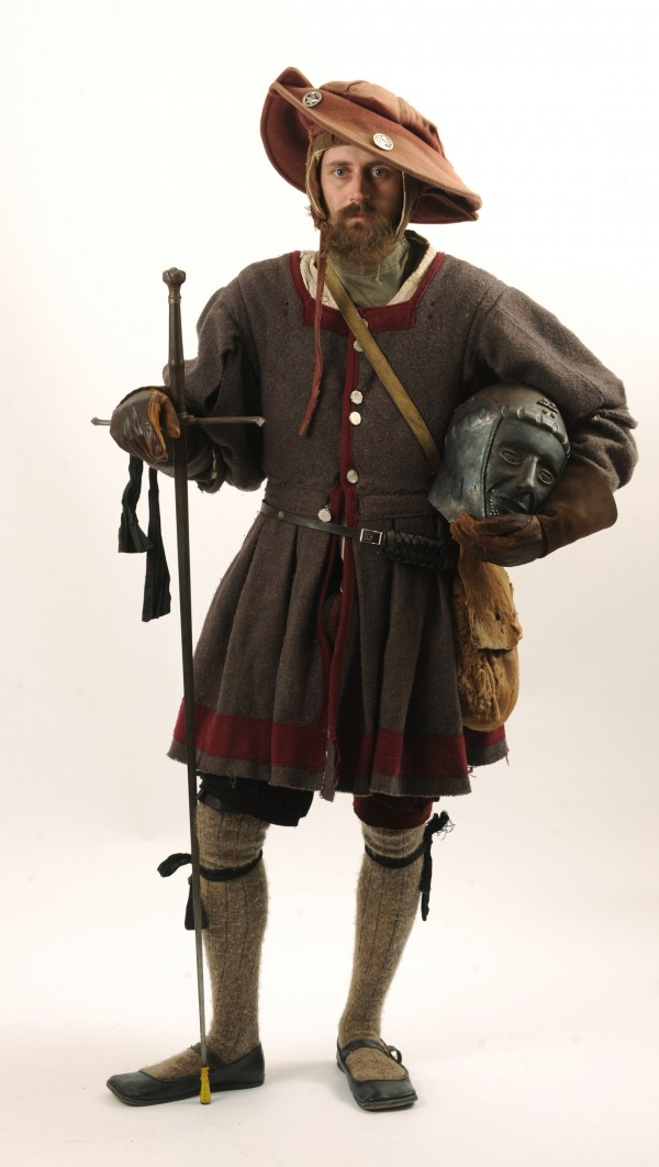 Matt Johnston of Dedham aka Matthaus Kettner, his SCA name, poses in his 1520s Bavarian dress. Johnson is a metalsmith who created his own fencing helmet made from hammered sheet steel in his work shop. Johnston has also created metal armor made in the same fashion.
