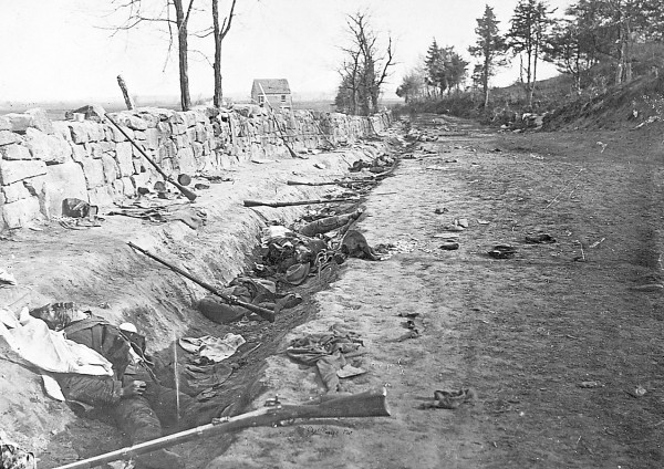 Carrying his camera equipment at Fredericksburg, Va. on Sunday, May 3, 1863, Andrew J. Russell photographed the section of the Stone Wall captured 20 minutes earlier by the 6th Maine Infantry. Charging from left to right, the Maine soldiers overran Confederate defenders along the wall and then climbed Marye's Heights to capture seven cannons belonging to the Washington Artillery. At least three — and possibly four — dead soldiers are sprawled in the ditch between the Sunken Road and the stone wall.