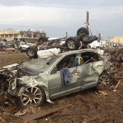 Whole neighborhoods razed by Oklahoma tornado that killed 24