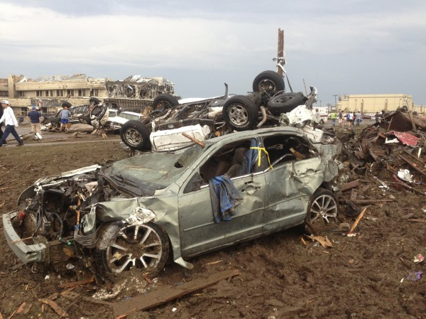Overturned cars are seen from destruction from a huge tornado near Oklahoma City, Oklahoma  May 20, 2013.