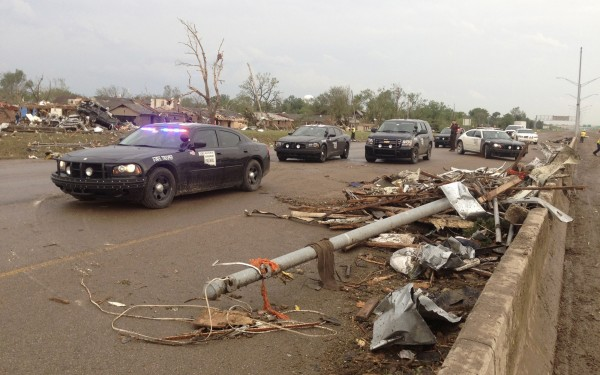 Law enforcement officials arrive on the scene after a huge tornado struck Moore, Oklahoma, near Oklahoma City, May 20, 2013. The powerful tornado that struck the town of Moore, Oklahoma, on Monday was given a preliminary rating of at least EF4, or the second highest strength level, with winds of up to 200 miles per hour, a U.S. government agency said.