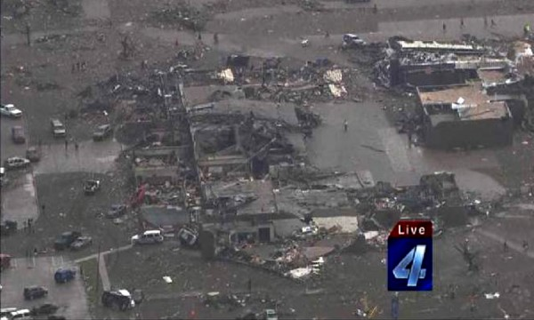 An aerial view of damage in the aftermath of a tornado that touched down in Moore, Oklahoma May 20, 2013 is seen in this still image from video provided by KFOR-TV.