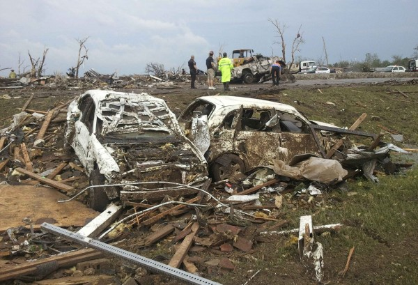 Destroyed cars are seen after a huge tornado struck Moore, Oklahoma May 20, 2013. A huge tornado with winds of up to 200 miles per hour devastated the Oklahoma City suburb of Moore on Monday, ripping up at least two elementary schools and a hospital and leaving a wake of tangled wreckage.