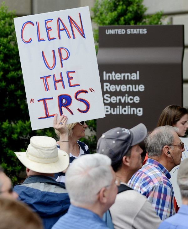 Tea Party supporters rally in front of the IRS building May 21, 2013 in Washington, D.C., to protest the abuse of power from the IRS in targeting tea party and grassroots organizations for harassment.