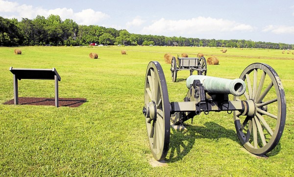 A 12-pounder Napoleon cannon and a limber stand near Union artillery lunettes at Fairview, part of the Chancellorsville battlefield in Virginia. On Sunday, May 3, 1863, the 5th Maine Battery deployed at the edge of the woods on the horizon directly above the cannon.